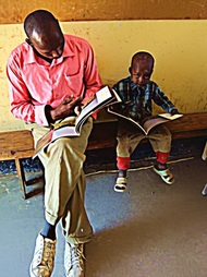 Teacher and Student Reading Wild Nature Institute's Lucky The Wildebeest book