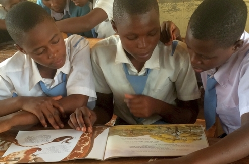 Children read giraffe-themed education materials_Wild Nature Institute